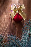 Big red christmas ball and gold colored bow with branches of fir Royalty Free Stock Photo