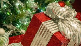 Big Red Christmas present with tree blurred in left of frame. stock photos