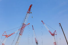 Big red crane at construction site Royalty Free Stock Image