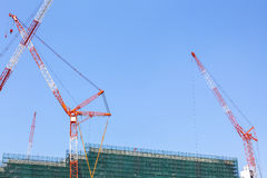 Big red crane at construction site Royalty Free Stock Images