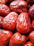 Big Red Date - Jujube Fruit. Closeup to a big Red Date - Jujube Fruit - /Fructus Jujubae among some small ones. They are different types. Ziziphus jujuba Stock Photo