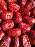 Big Red Date - Jujube Fruit. Closeup to a big Red Date - Jujube Fruit - /Fructus Jujubae among some small ones. They are different types. Ziziphus jujuba Royalty Free Stock Photos
