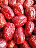 Big Red Date - Jujube Fruit. Closeup to a big Red Date - Jujube Fruit - /Fructus Jujubae among some small ones. They are different types. Ziziphus jujuba Royalty Free Stock Photo