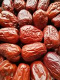 Big Red Date - Jujube Fruit. Closeup to a Red Date - Jujube Fruit - /Fructus Jujubae on black background.Ziziphus jujuba,commonly called jujube, red date Stock Image