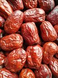 Big Red Date - Jujube Fruit. Closeup to a Red Date - Jujube Fruit - /Fructus Jujubae on black background.Ziziphus jujuba,commonly called jujube, red date stock photo