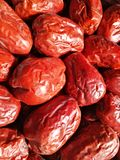 Big Red Date - Jujube Fruit. Closeup to a big Red Date - Jujube Fruit - /Fructus Jujubae among some small ones. They are different types. Ziziphus jujuba Royalty Free Stock Image