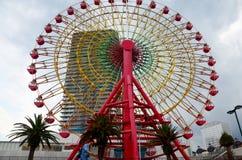 Big red ferris wheels forl people play at Kobe Harborland Stock Images