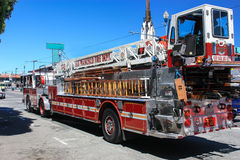 Big red fire engine standing on the road. Big fire truck ready to help in any emergency. Royalty Free Stock Images