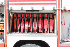 big red fire truck hoses fighting services in fire truck Royalty Free Stock Images