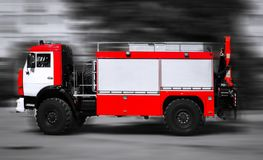 Red fire truck in motion. Stock Image