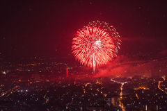 Big Red Firework over city Stock Photos