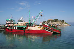 Big Red Fishing boat docked by Kusadasi Castle Royalty Free Stock Image