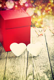 Big Red Gift Box And White Hearts On Wooden Board. Stock Photography
