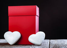 Big Red Gift Box And White Hearts On Wooden Board. Stock Image