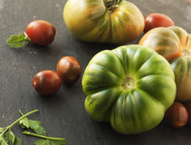 Big red and green tomatoes. Tomatoes cherre Royalty Free Stock Photography