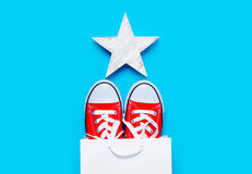 Big red gumshoes in cool shopping bag and beautiful star shaped Royalty Free Stock Photos