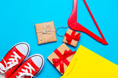 Big red gumshoes, cool shopping bag, hanger and beautiful gifts Royalty Free Stock Image