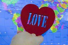 Big red heart  on a background map of earth Royalty Free Stock Photos