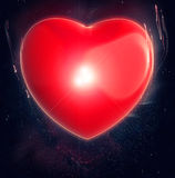Big red heart glowing Stock Images