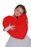 Big red heart in the hands of a girl. In a wedding dress Stock Photography
