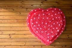 Big red heart on the natural wooden background . Copy space stock photography