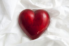 Big red heart. On satin for background use Royalty Free Stock Photo