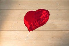 Big red heart shaped balloon Stock Photography