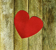 Big red heart velvet paper on old wooden boards close up Royalty Free Stock Photos