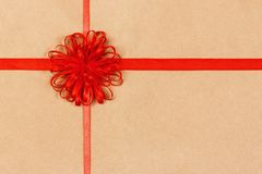 Free Big Red Holiday Bow On Brown Box Background Top View Vith Copy Space. Toned Stock Photo - 165201650
