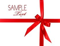Big Red Holiday Bow Package on White Background Stock Images