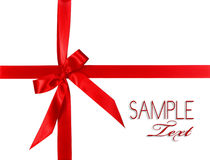 Big Red Holiday Bow Package on White Background. With Copy Space Stock Images