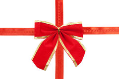 Big red holiday bow and ribbon isolated. On white background Royalty Free Stock Photography