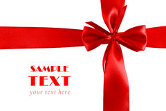 Big red holiday bow on white. crosswise Royalty Free Stock Image