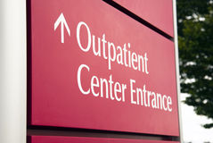 Big Red Hospital Outpatient Center Emergency Entrance Health Car. Street sign at the local hospital Stock Photo