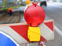 Big red lamp to signal roadworks and road works Royalty Free Stock Photography