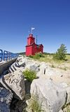 Big red lighthouse in Michigan. Big Red Lighthouse from fishing pier in Holland, Michigan Stock Image
