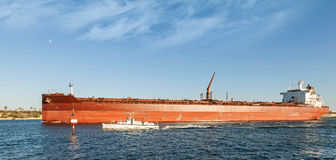 Big red oil tanker passes through the Suez Canal Stock Photo