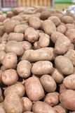 Big red potatoes in a grocery Stock Photos