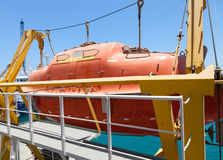 Big red rescue boat on the passenger ship Stock Images