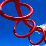 Big red rings in playground. Three Big red rings on blue sky in a playground Royalty Free Stock Photography
