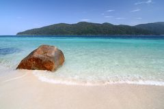 Big Red Rock On White Beach. A Big Red Rock on White Beach Royalty Free Stock Image
