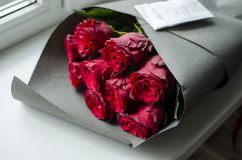 Big red rose bouquet. Nice happy birthday gift. Present from man. To a woman Stock Photo