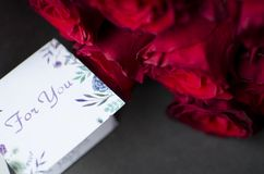 Big red rose bouquet. Nice happy birthday gift. Present from man. To a woman Royalty Free Stock Photography