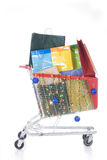 Big red shopping cart full of shopping bags Stock Images