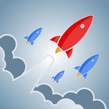 Big red and smaller blue rockets. Vector retro design elements. Stock Photography
