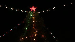 The big red star on a Christmas tree stock video footage