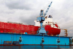 Big red tanker repair in blue floating dock Royalty Free Stock Photos