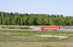 Big red truck shot from far away Stock Images