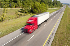 Big Red Truck Speeding Down Highway Stock Photo