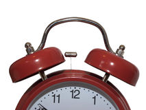 Big red vintage clock. A big red analogue alarm clock isolated on white Royalty Free Stock Photography